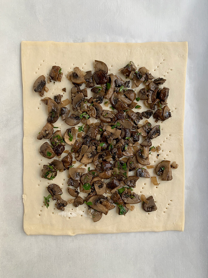 mushrooms on docked puff pastry