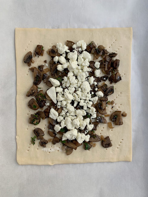 goat cheese layered on to the mushrooms on the puff pastry