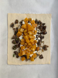 mushrooms, goat cheese and butternut squash layered on puff pastry