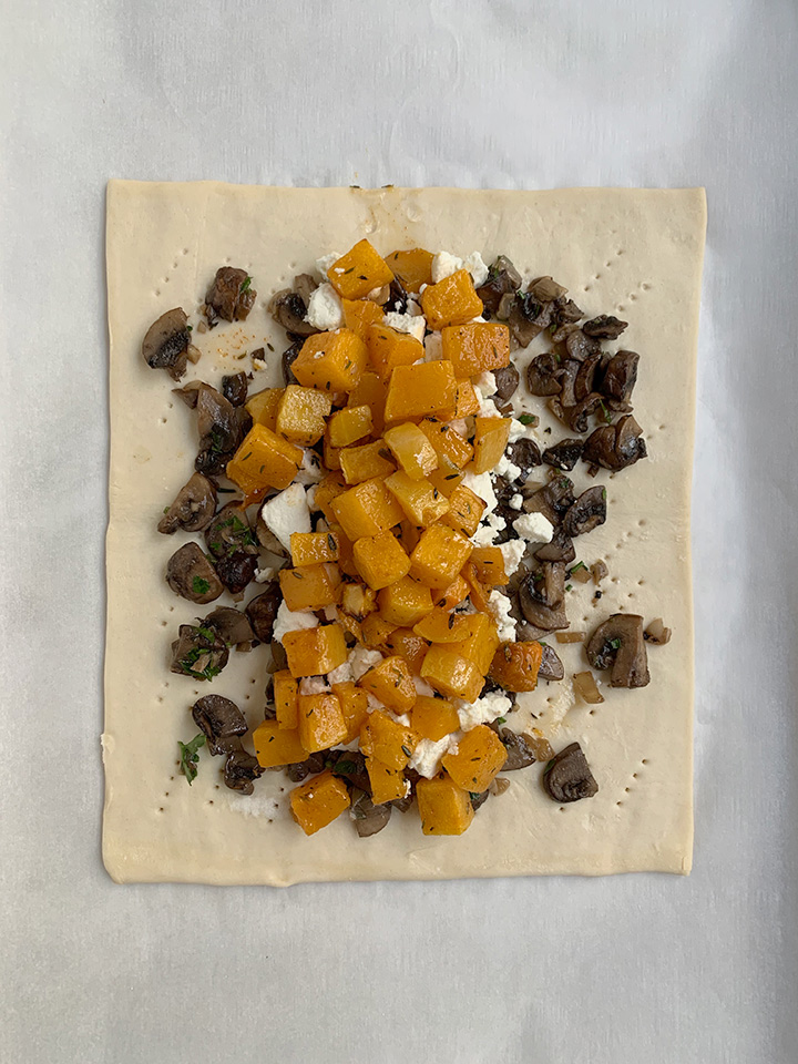 squash layered onto goat cheese and mushrooms on top of puff pastry