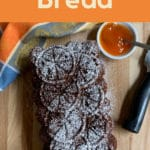 pinterest image showing whole loaf with knife and a napkin plus dried fruit and persimmon pulp
