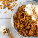 pinterest image with granola and yogurt in grey bowl with wooden spoon