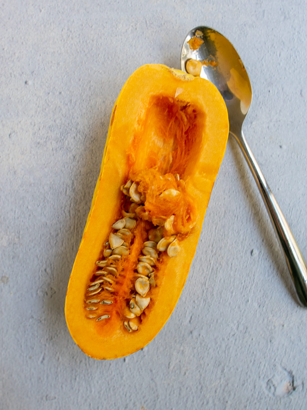 spoon and half seeded delicata squash